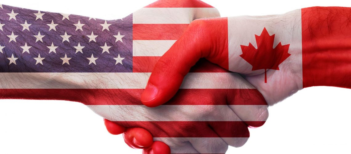 AMERICAN AND CANADIAN SHAKING HANDS