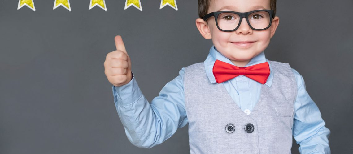 Cute,Little,Boy,Giving,Thumbs,Up,With,5,Stars,Approved