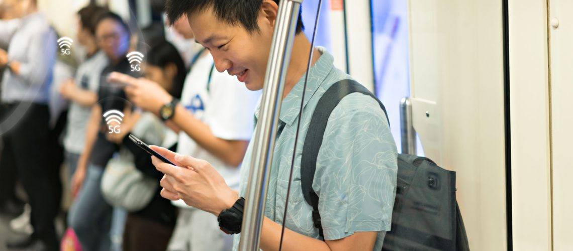 Happy,Man,Is,Traveler,Using,Smartphone,With,5g,Connection,At